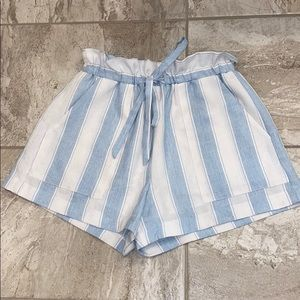 white and light blue striped paper bag shorts